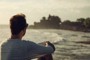 man relaxing on Laguna Beach after dialectical behavior therapy